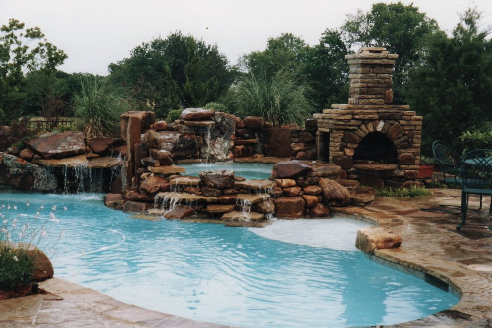 boulder-waterfall-swimming-pool-spa-fireplace-outdoor-natural