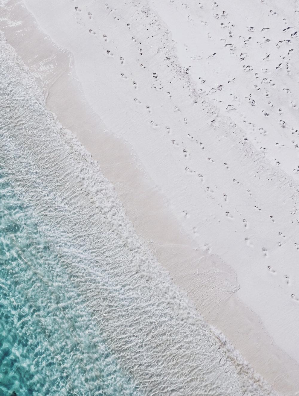 footprints.sand.ocean.jpg