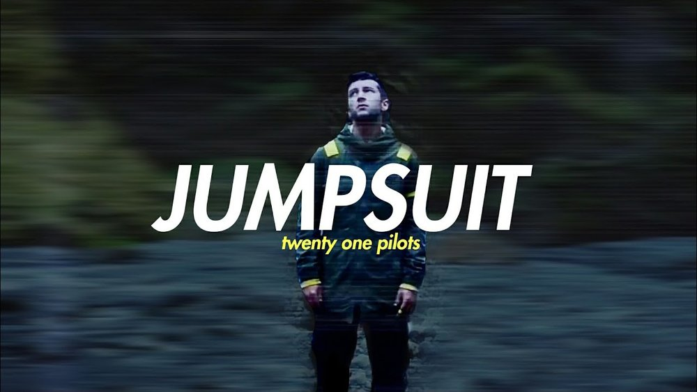 "At The 5th, we usually like to focus on artists you may not hear on mainstream radio. Today that changes with this incredible song from Twenty One Pilots.  The groups front man, Tyler Joseph, grew up as kid that dealt with deep insecurities.  Some of them even following him into his adulthood.     Today we're highlighting their song called ""Jumpsuit"". The lyrics to this song definitely speak of being in a place where the pressures of life try to stop you from growing.  Since we didn't want to put our words to describe it, just take some time and Google them for yourself.    Find out more about Twenty One Pilots at  http://www.twentyonepilots.com."