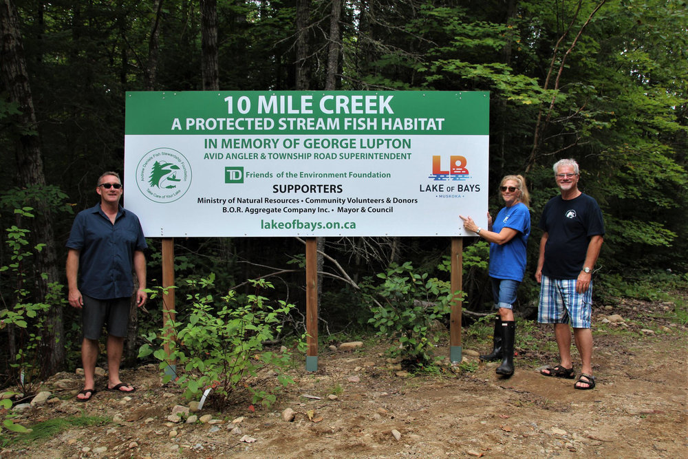 Six years working on this project and it's finally done. Special thanks to our liason Councillor Terry Glover for working with staff and fellow council members for the approval of the sign. Also thank you to Huntsville's RBC branch for their Community Day of Service and grant, Cathy Nystrom and Daphne Curtis who assisted with tree and shrub planting. Missing from the photo are George Daniels, Ben Boivin, MNR Biologist Steve Scholten who were the drivers for the Ten Mile Creek repair work. In photo Secretary/Treasurer - J. Godard, President - C. Daniels and Director D. Rolland.