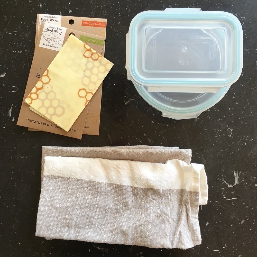 The basics: reusable food wrap, glass food containers, cloth napkins AND wax paper snack/ sandwich bags (not shown).