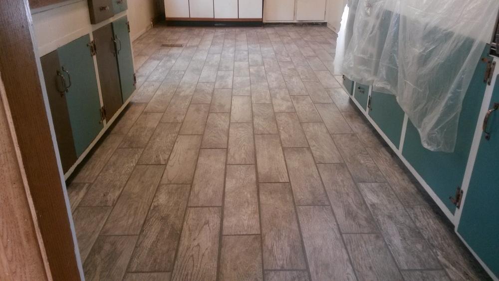 New Darker Colored Porcelin Hardwood Looking Tile Installed.jpg