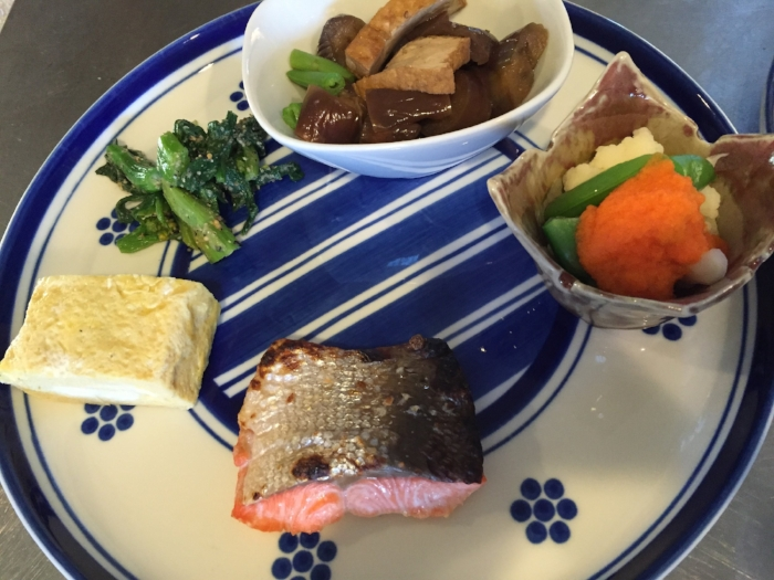 Califlower and sugar peas with orange ginger dressing, braised eggplant and fried tofu, blanched yuchoi with sesame sauce, tamagoyaki omelette, shio-koji marinated sockeye salmon