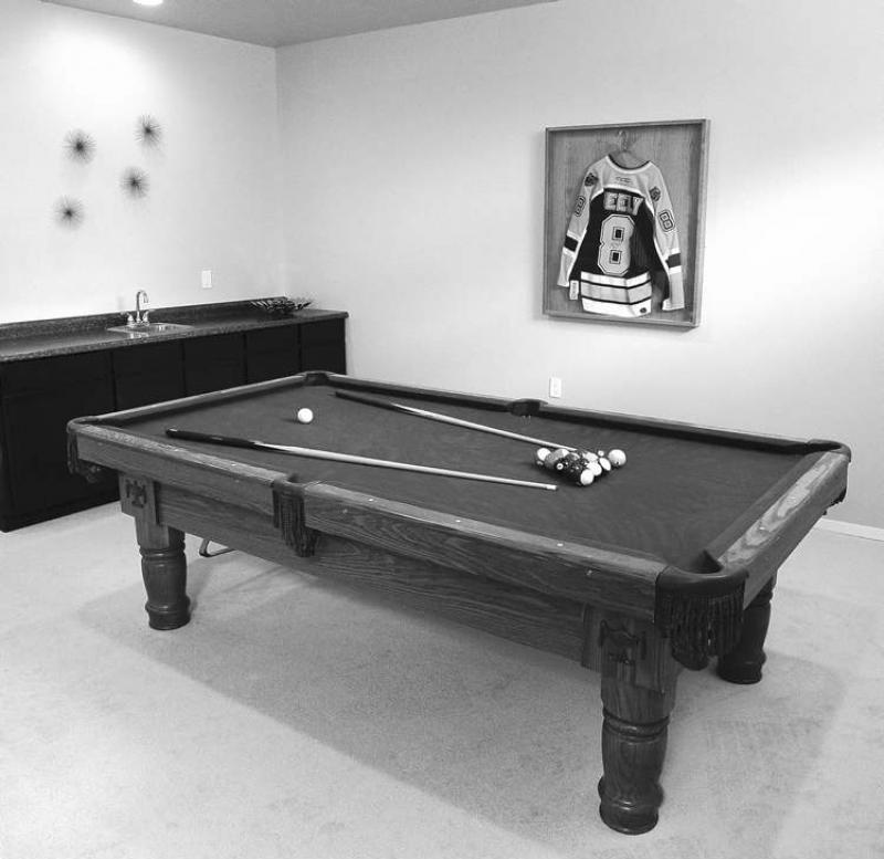 The basement is fully finished with a games room, a wet bar and an extra room that could serve as a bedroom or computer room.