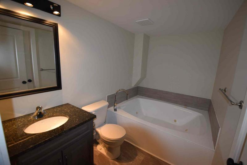 TODD LEWYS / WINNIPEG FREE PRESS/The ensuite on the mid-level is a great spot to relax with a jetted soaker tub surrounded by rich finishes.