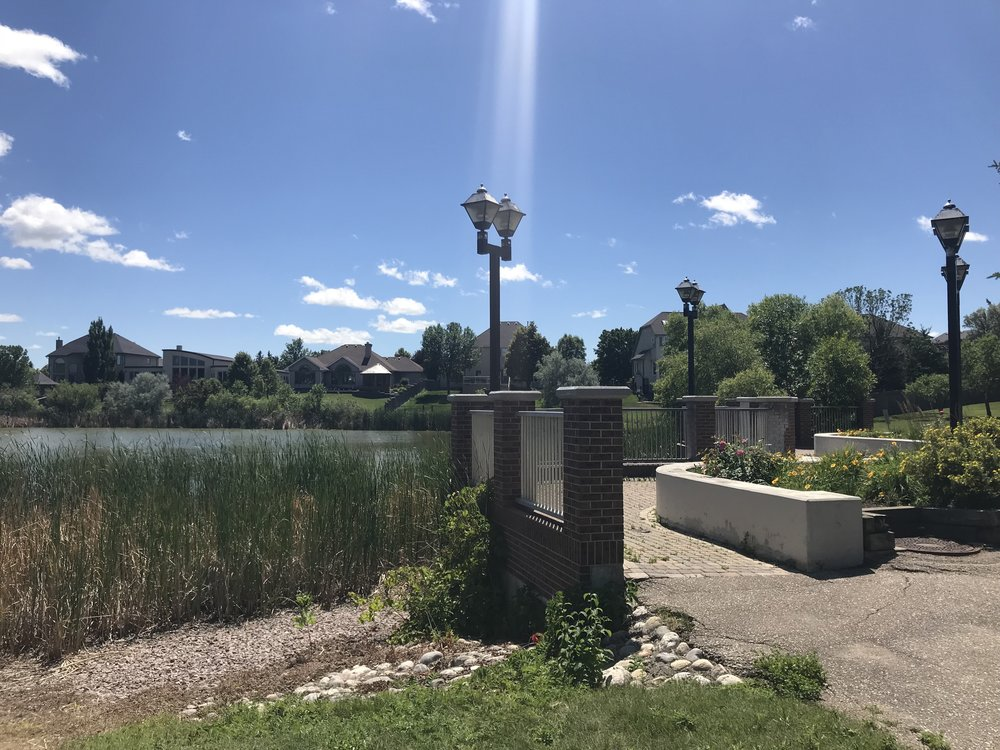 One of many spots in the community to sit and admire the lake