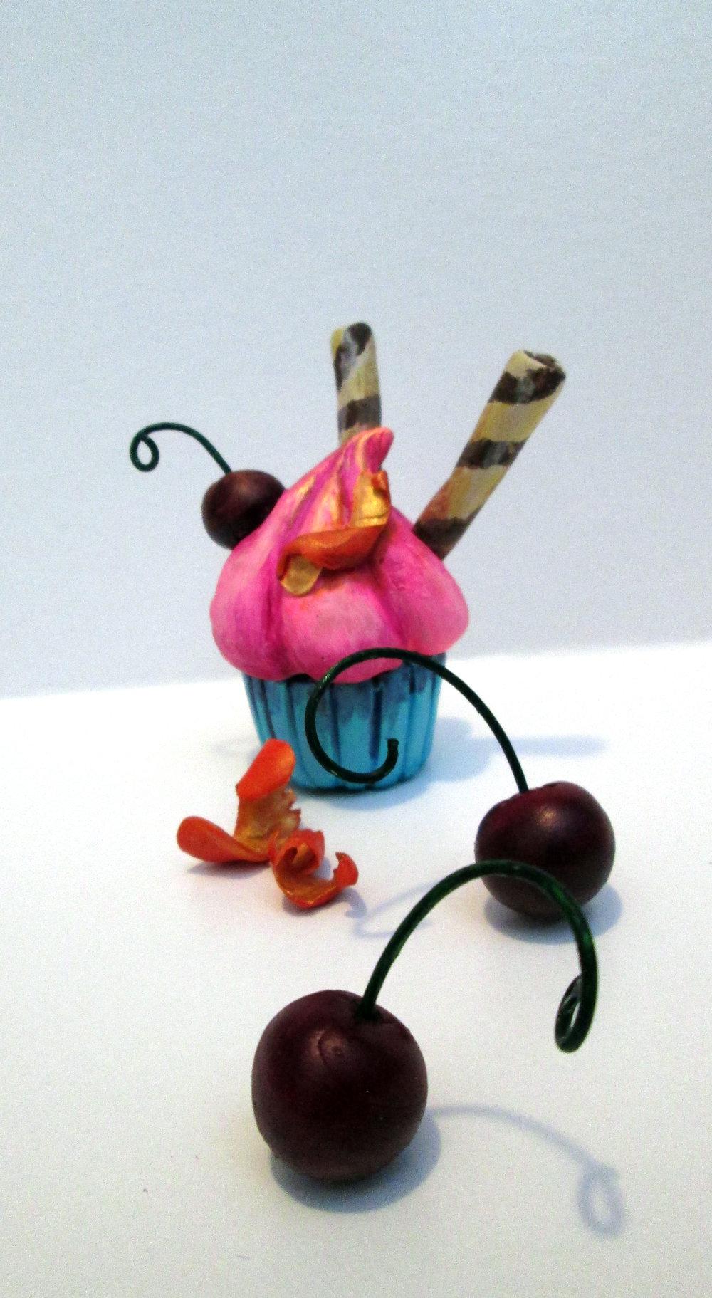 Celebration Cupcake  Polymer clay, acrylic paint, aluminum wire.