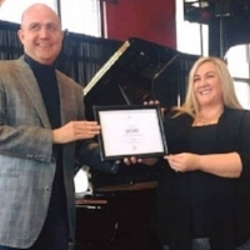 "Teacher Award Announcement: We are pleased to announce that one of our instructors, Mrs. Crystal French, has recently been presented with the ""Piano Teacher of the Year"" Award by Mark Love of the Steinway Piano Gallery of Charlotte. Congratulations, Mrs. Crystal!"