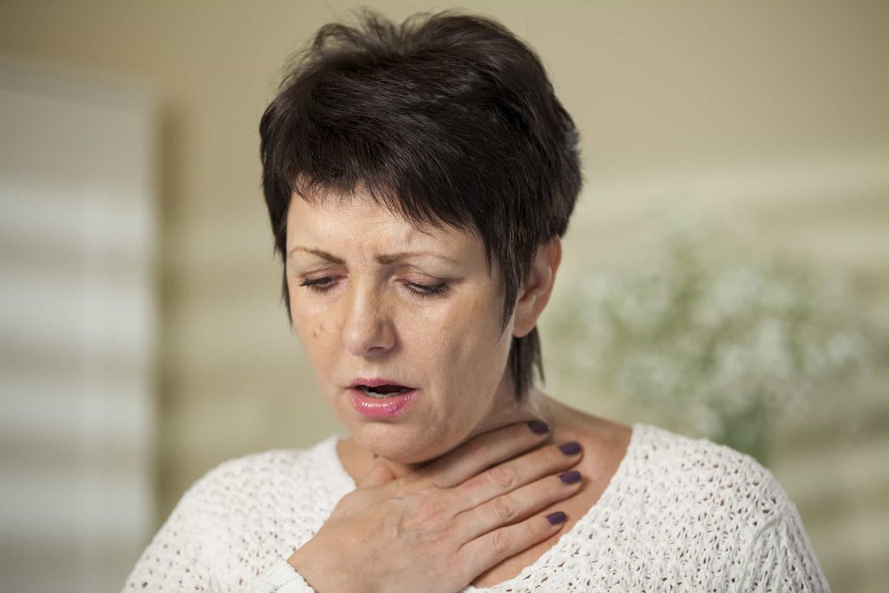 woman having trouble breathing