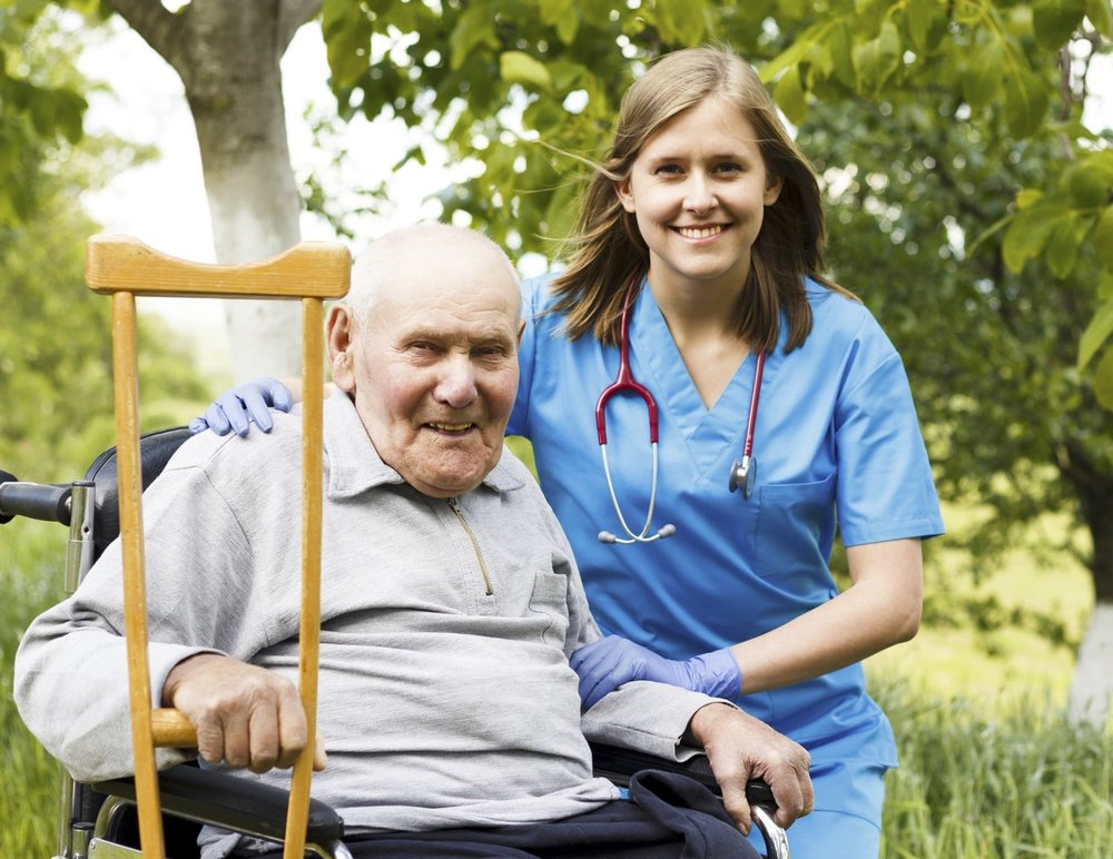 man-with-nurse-getting-post-acute-care