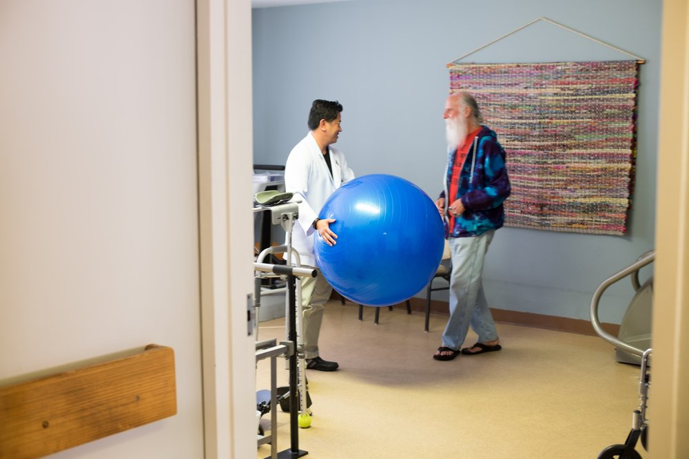 man-and-doctor-act-physical-therapy