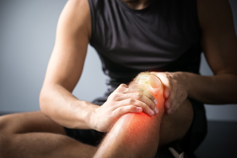 man-holding-knee-after-injury