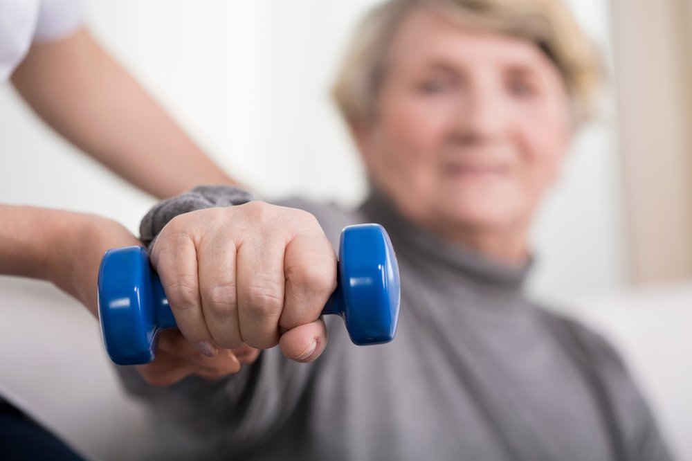 woman-holding-dumbbell