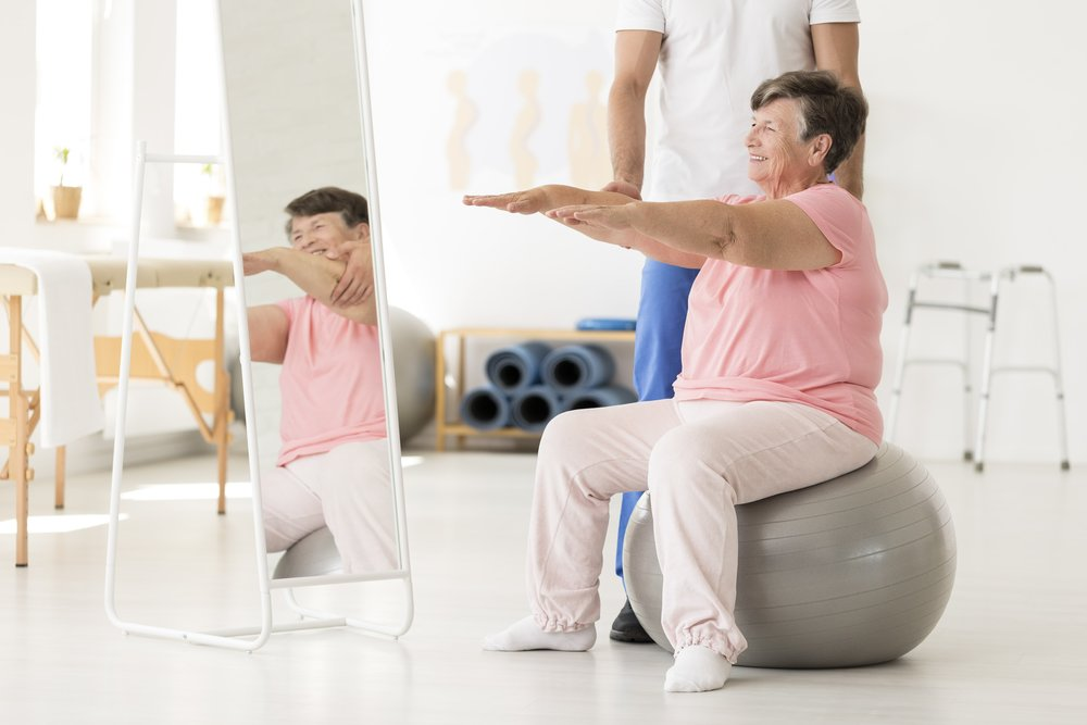 senior-exercising-with-physical-therapist