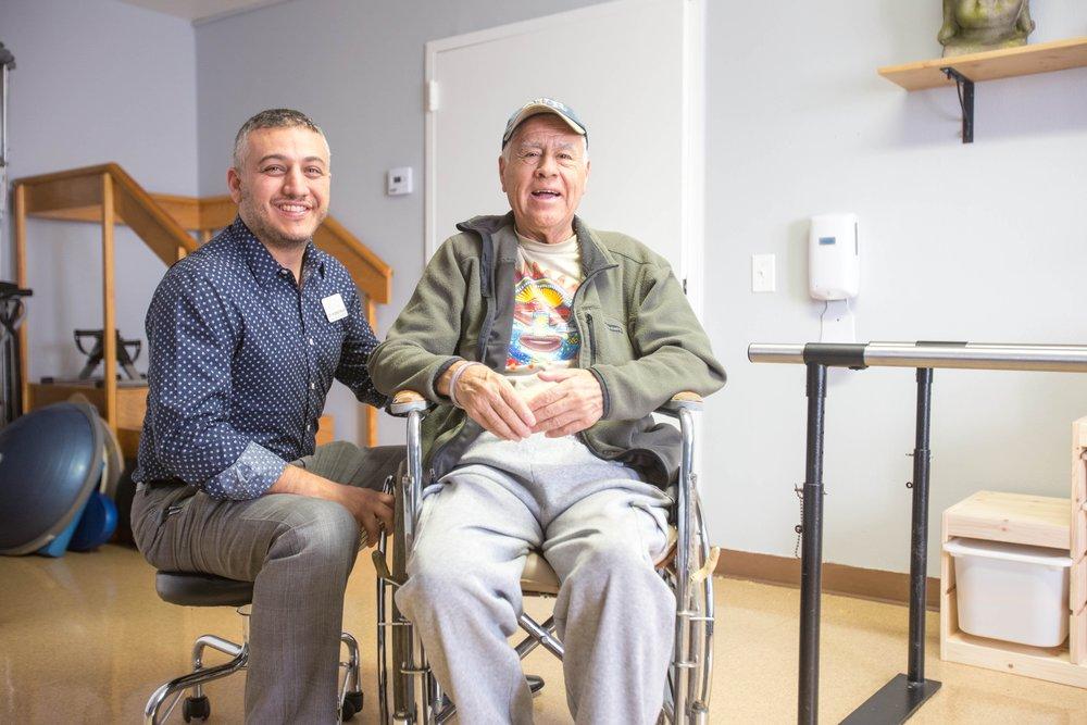 senior-man-sitting-with-thearpist