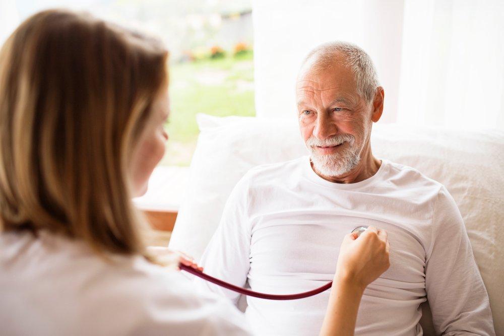 senior-man-getting-checked-by-nurse