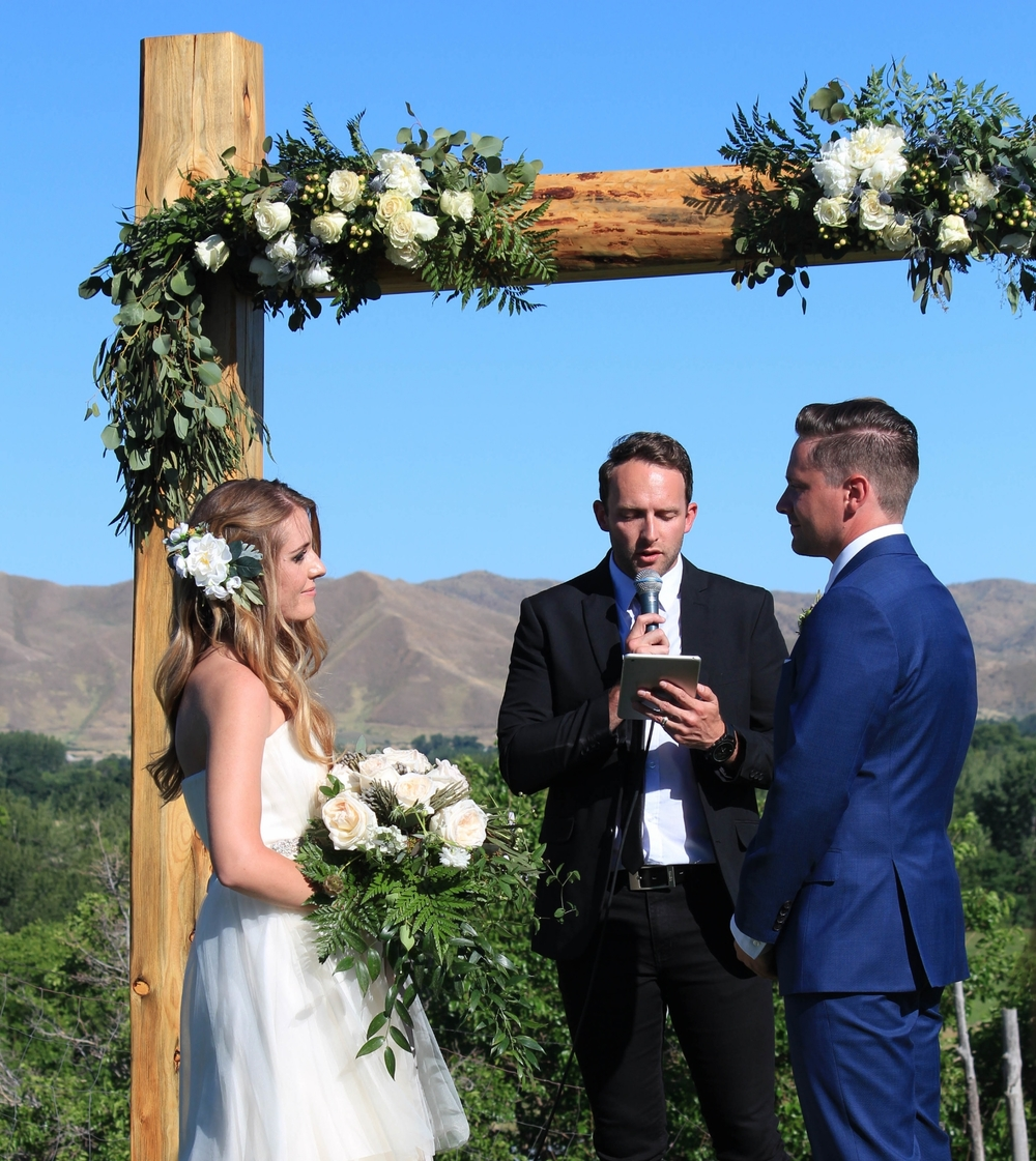 Ceremony with blush rose arch - Dylan and Sarah Photography