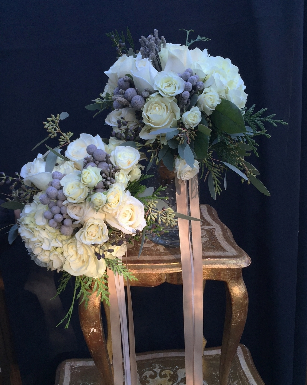 White bridesmaid bouquets with pale gold streamers