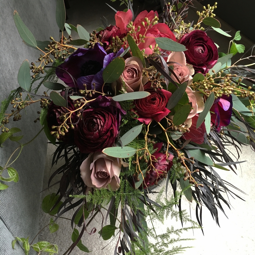 Dark & moody bride's bouquet, tree peony, sahara roses, agonies, ranunculus, eucalyptus