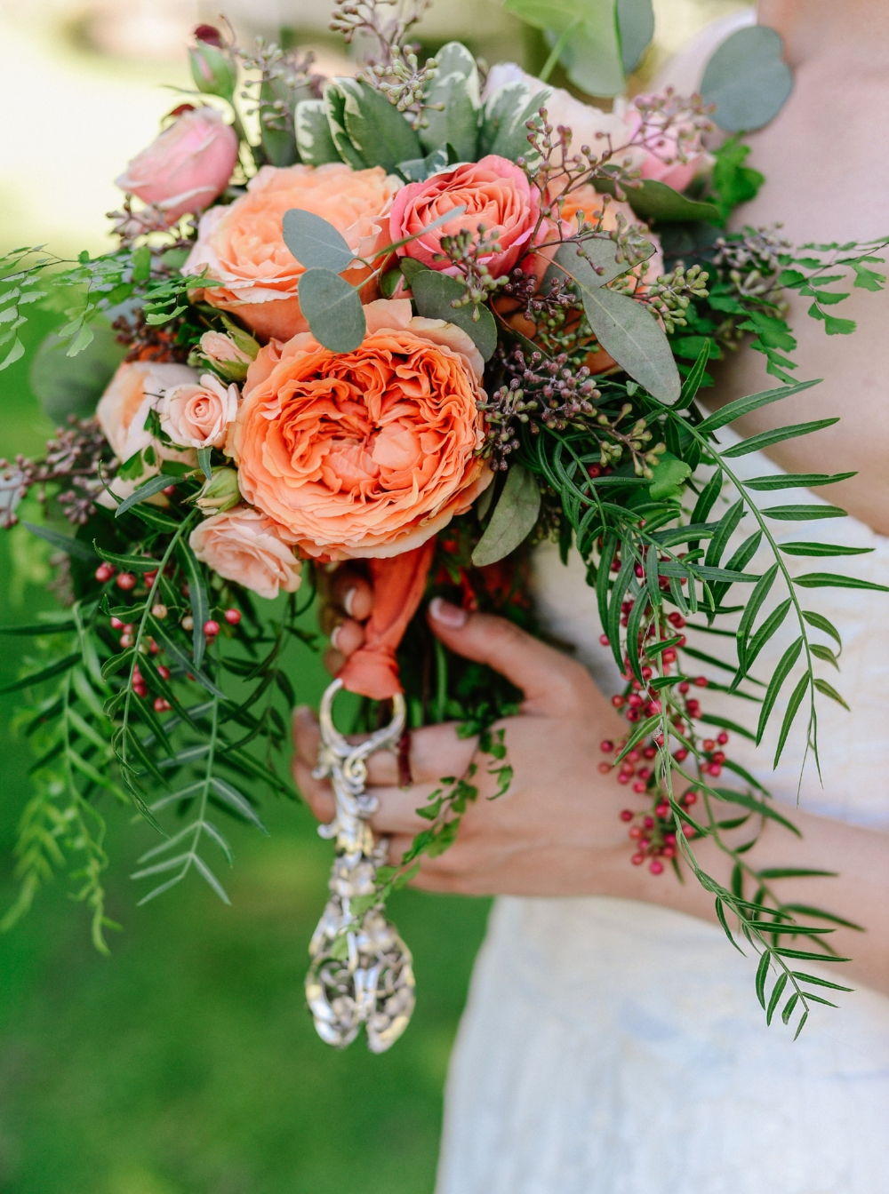 Peach bouquet with family antique silver charm - Jerome Tso Photography