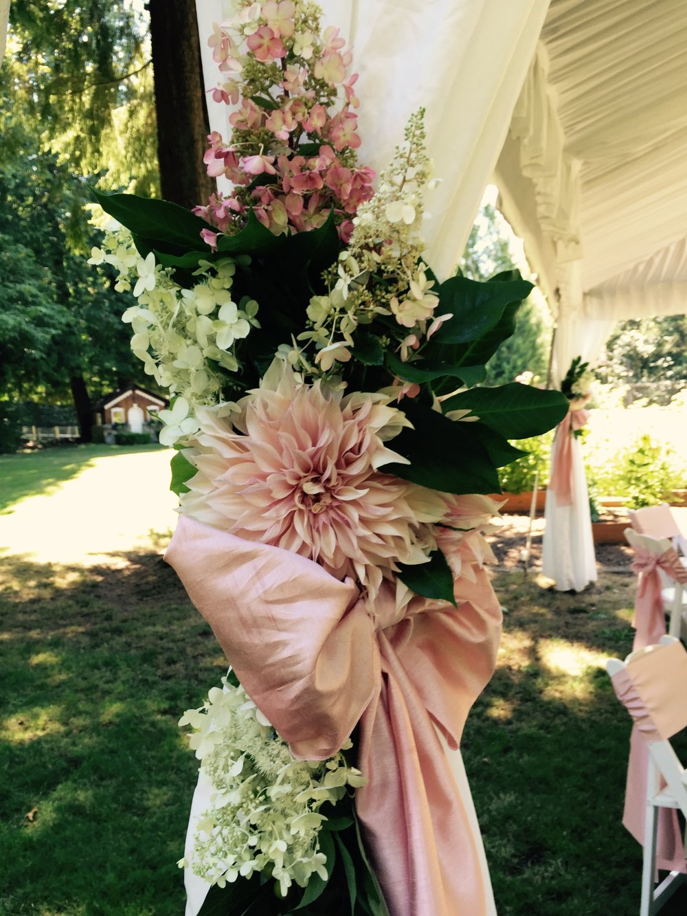 Blush tent tie-back with Cafe au Lait dahlias