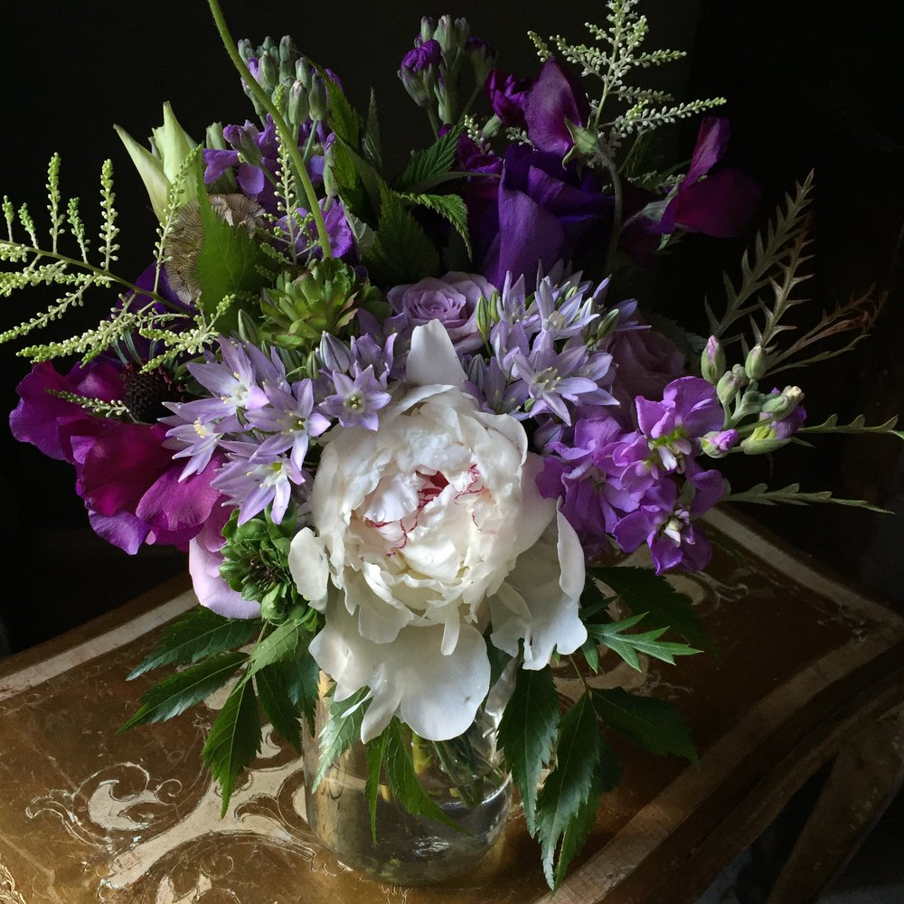 Bridesmaid bouquet in purples, stock, peonies, sweetpeas