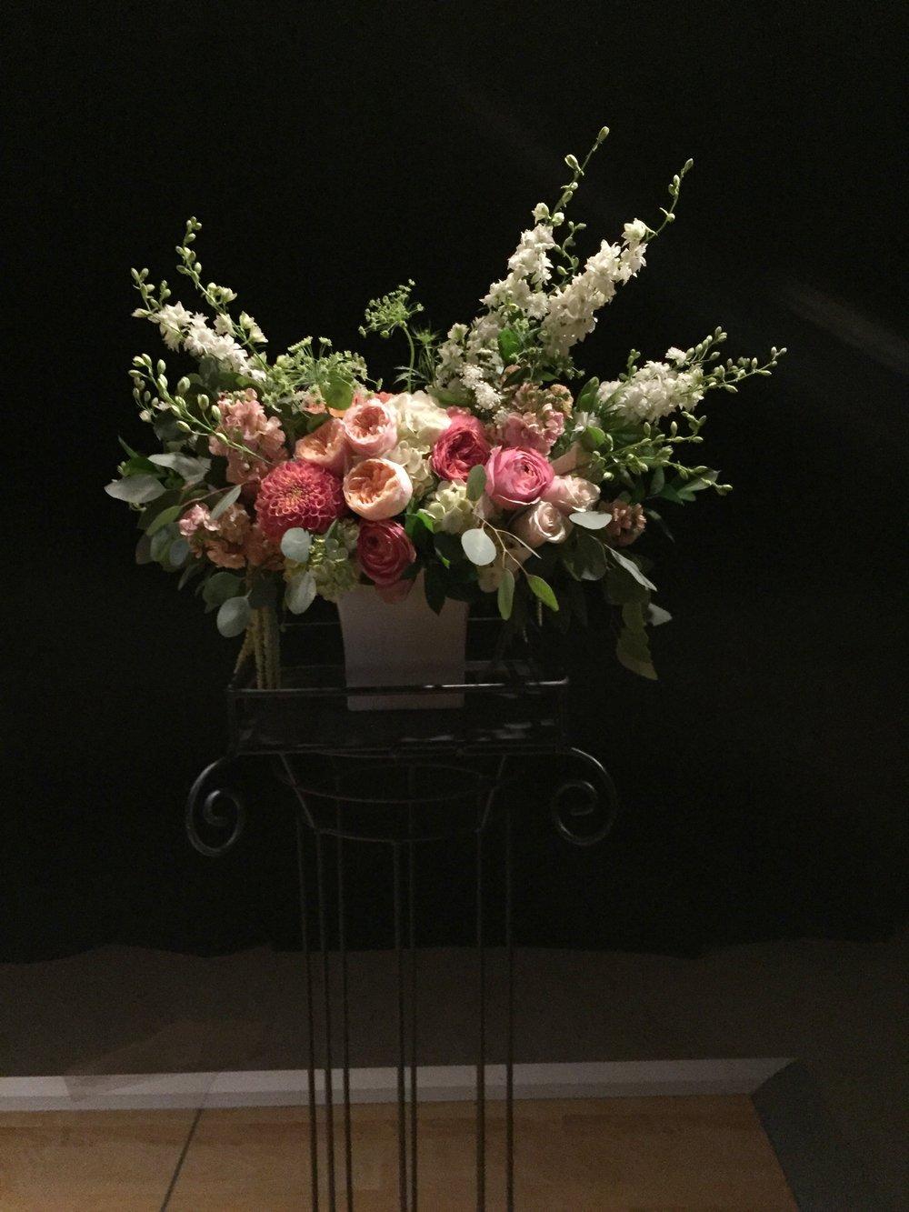 Ceremony pedestal arrangements in peach