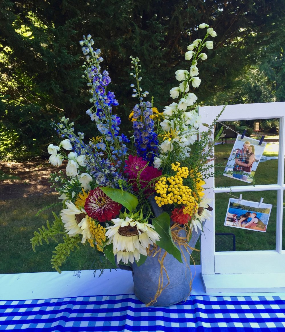 Wildflower theme watering can floral with white sunflowers, delphiniums & zinnias