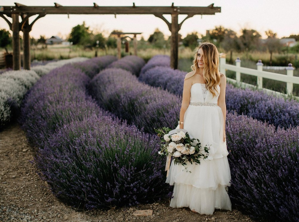Kelli in lavender field with blush bouquet by Dylan and Sara Photographer