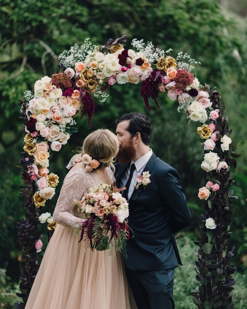 Beautiful  flowered arch in graduated tones pale to burgundy. via www.weddingapp.com Eric Ronald Photography