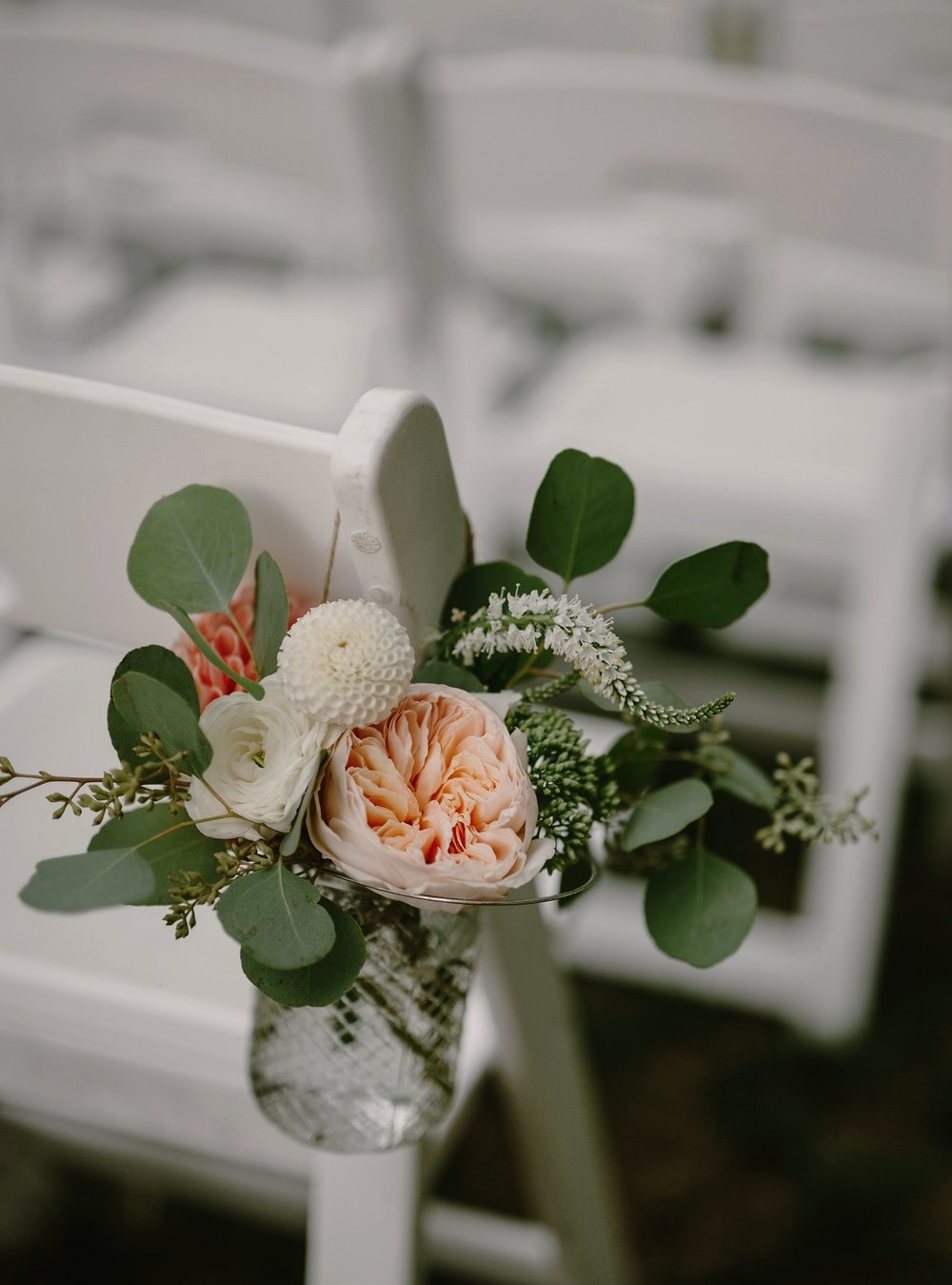 Aisle decor with garden roses & eucalyptus
