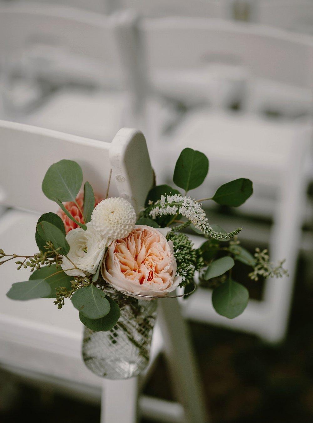 Aisle decor with garden roses & eucalyptus