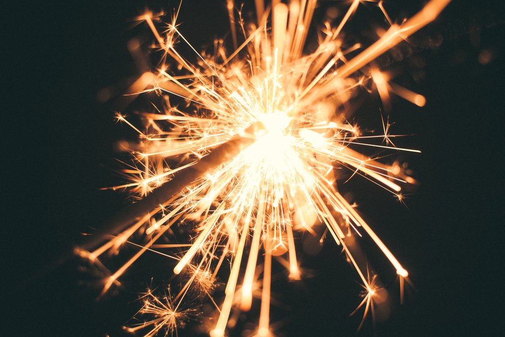 celebrate your mini miracles. this image is of a sparkler.