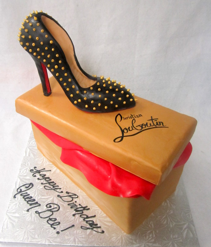 black heel with studs on shoebox.JPG