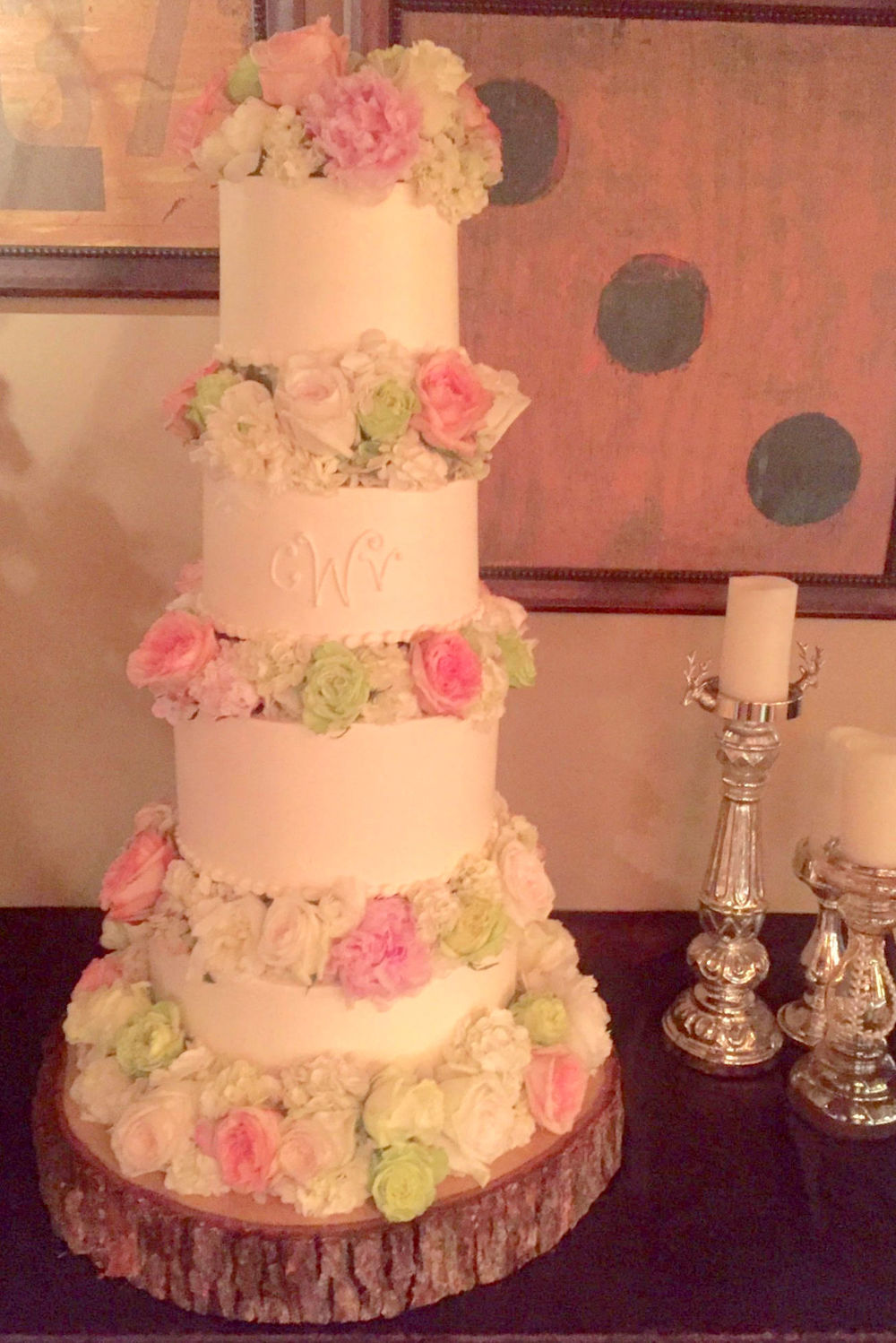 wedding cake  with flowers and tree stump.jpg