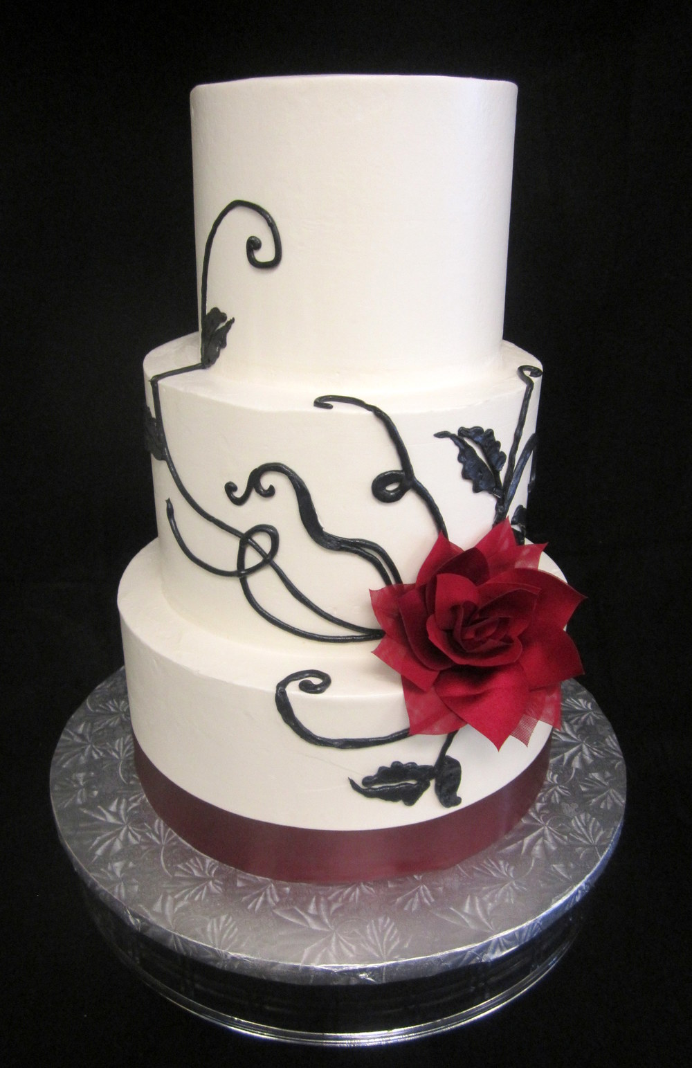 wedding-burgundy silk flower and black scrolls.jpg