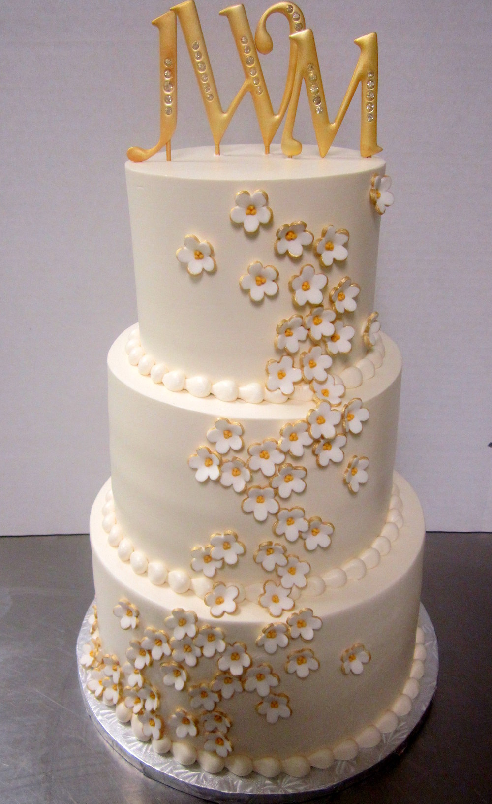 wedding-white and gold flowers tumbling.JPG