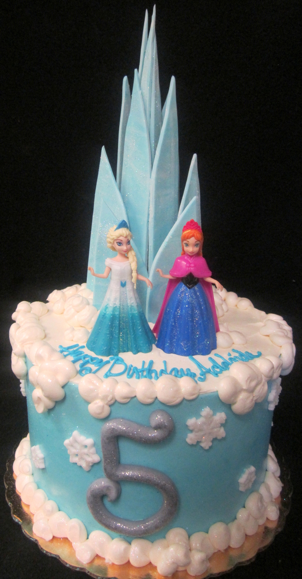 frozen shard castle with girls cake.jpg