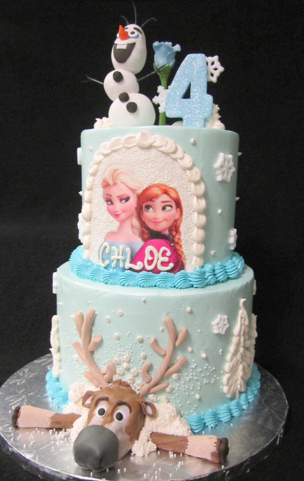 frozen with reindeer and princesses with olaf on top cake.jpg