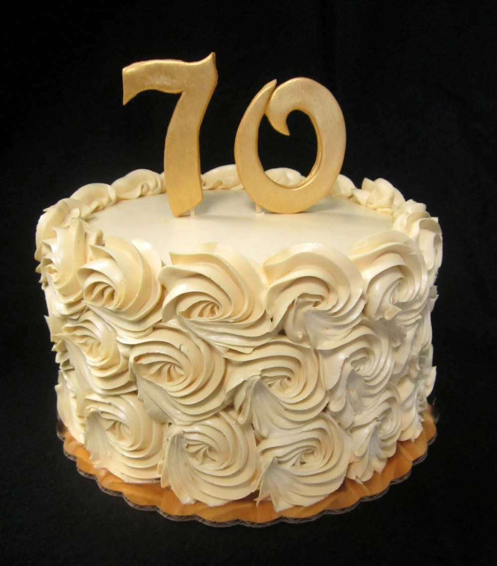 gold rosettes with 70 cake.jpg
