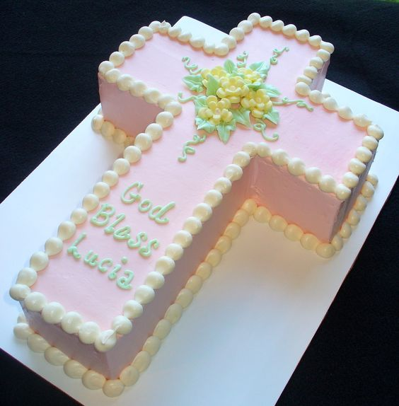 pink cross cake with yellow flowers.jpg