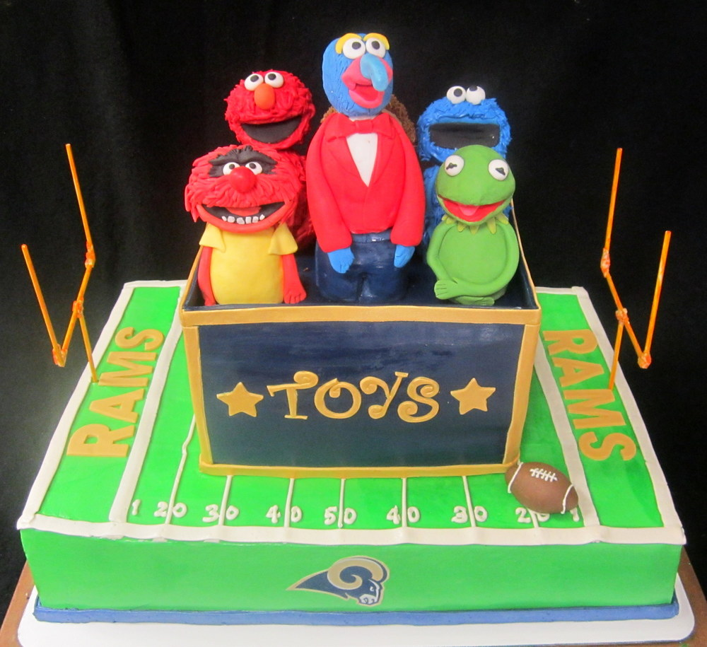 muppets in toy box on football field.jpg