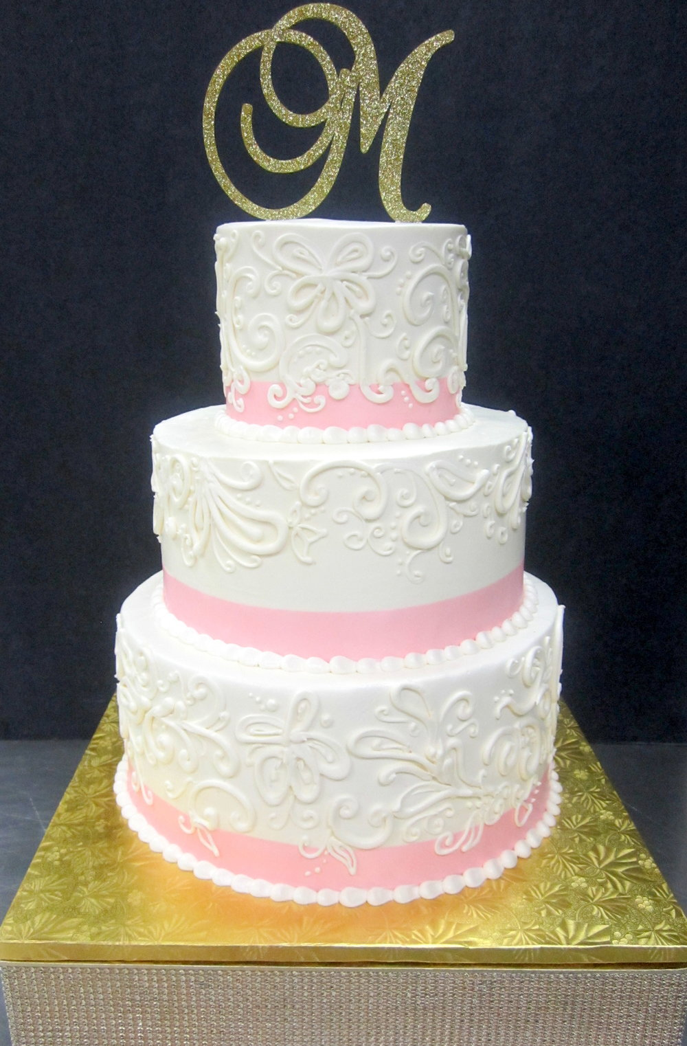 wedding-buttercream scrolls over pink ribbon.JPG