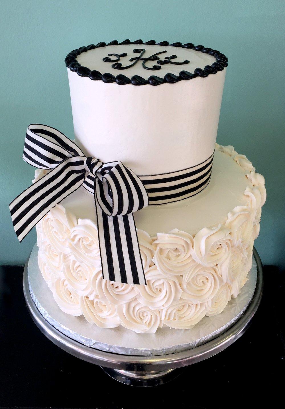 white rosettes and black and white bow cake.JPG