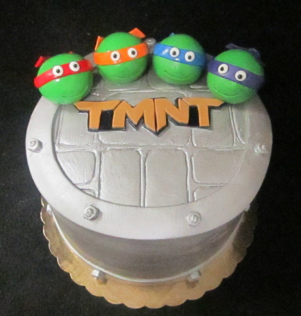 teenage mutant ninja turtle heads cake.JPG
