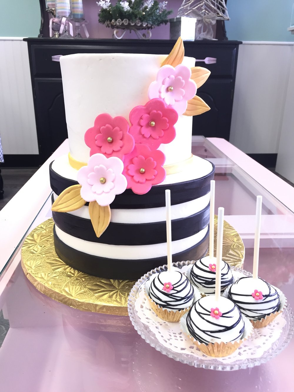 kate spade striped cake and black and white cake pops.jpeg