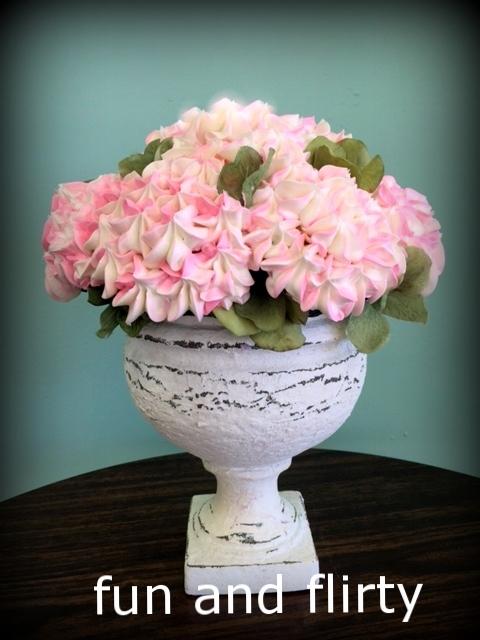 pedestal with pink and white hydrangeas.JPG
