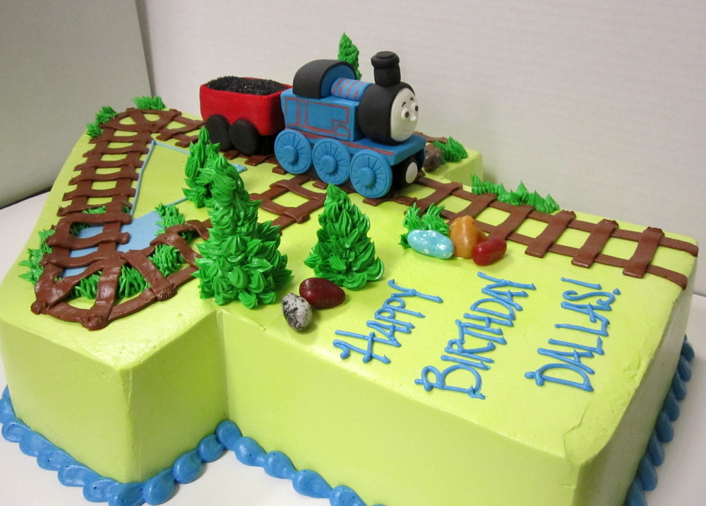 thomas track on number four sheet cake.JPG