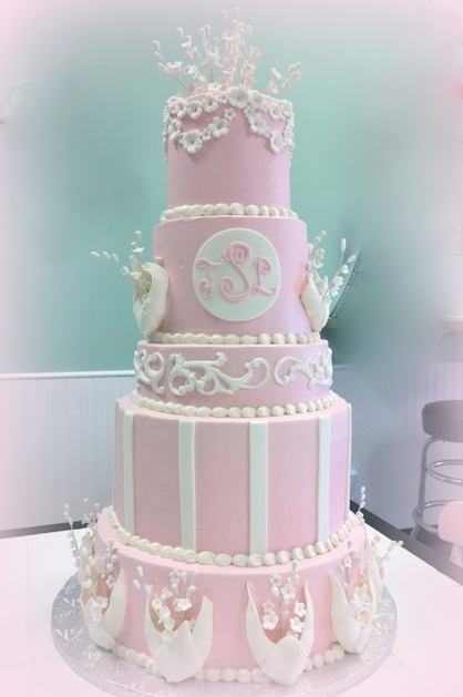 wedding cake - pink with white pockets and white flowers.JPG
