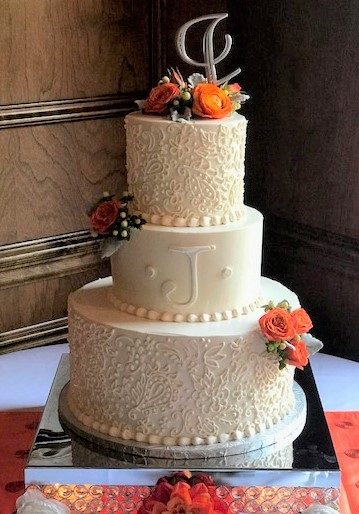 wedding- paisley scrollwork orange flowers.jpg